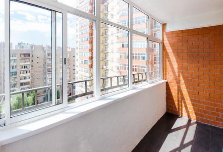 Glazed balcony with brick wall 写真素材