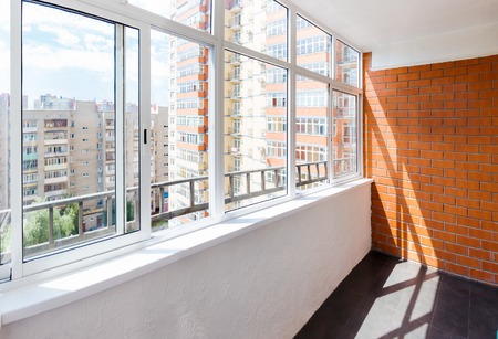 Glazed balcony with brick wall Foto de archivo