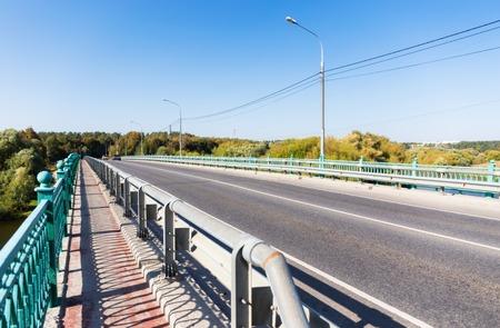fenced: Fenced sidewalk on the bridge