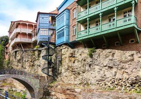 Beautiful old houses on the rocky relief.