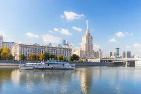 royal: MOSCOW - SEPTEMBER 15, 2015:  Radisson Royal Hotel (Hotel Ukraina) with pleasure boat on the foreground. Editorial
