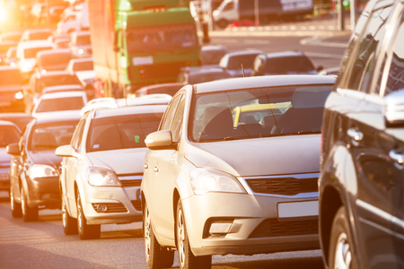 Side mirror view to the traffic jam on the highway under the sunlight Stock Photo
