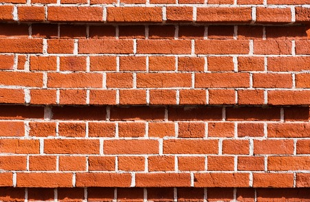 Red brick wall texture with white seams Stock Photo