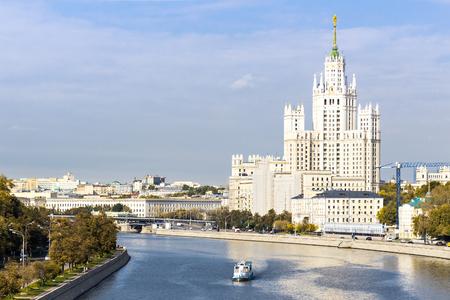 kotelnicheskaya embankment: Kotelnicheskaya embankment building with leisure boat on the river