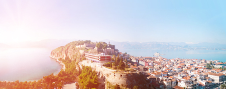 View from the Palmidi Fortress down to the old area of the city of NafplionNauplia and the Argolic Gulf with the fortress island Bourtzi. Stock Photo