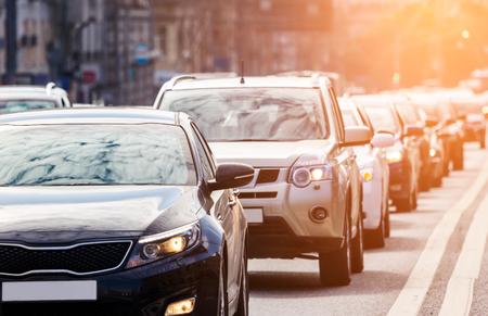 Close-up of the lane of cars in traffic jam against the sun Фото со стока - 74586622