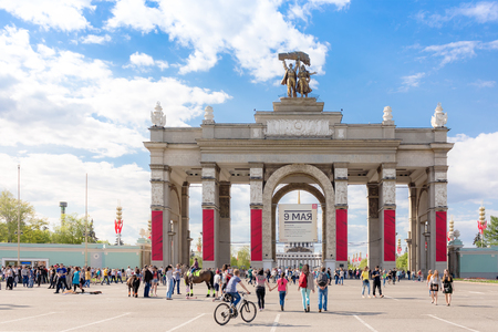 MOSCOW - MAY 8, 2016: Main entrance to VDNKh park complex decorated for the WWII victory celebration. This place was developed in soviet times as an Exhibition of Achievements of National Economy.