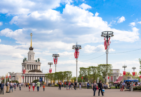 MOSCOW - MAY 8, 2016: People walking on the main alley of VDNKh park complex. This place was developed in soviet times as an Exhibition of Achievements of National Economy. Editorial