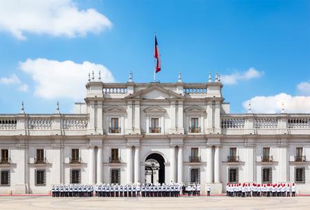 A public procession in front of La Moneda Palace (Palacio de La Moneda) in Santiago, Chile.