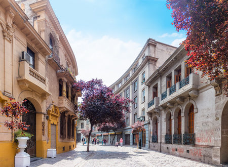 public housing: SANTIAGO, CHILE - OCTOBER 23, 2016: Street of Barrio Paris-Londres neighborhood. This european style area includes shops, hotels and cobble stone streets with renovated historic mansions.
