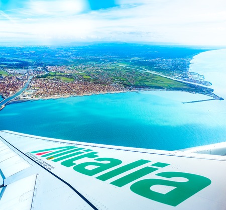 FIUMICINO, ITALY - NOVEMBER 13, 2016: View of the bay from the Alitalia aircraft with logo on the wing. This company is an italian flag carrier.