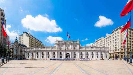 bandera chilena: SANTIAGO, CHILE - OCTOBER 23, 2016: Panoramic view of La Moneda Palace (Palacio de La Moneda). It is the seat of the President of the Republic and three cabinet ministers.