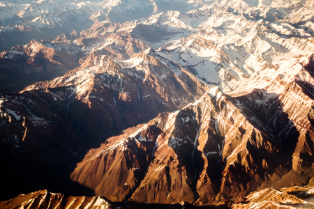 Aerial view of the mountains in brown color Фото со стока
