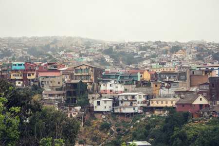 VALPARAISO, CHILE - OCTOBER 27, 2016: Central district of Valparaiso during gloomy weather. Valparaiso is most poorest and dangerous city in Chile. Редакционное