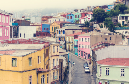 VALPARAISO, CHILE - OCTOBER 27, 2016: Street of Valparaiso during overcast. Valparaiso famous as a UNESCO World Heritage Site. Редакционное