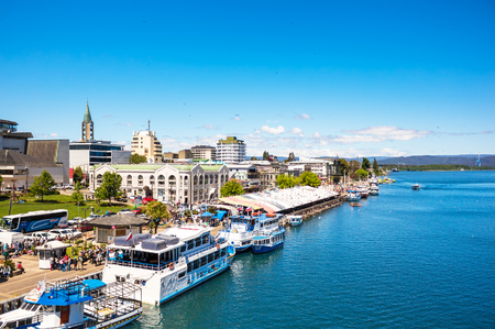 VALDIVIA, CHILE - OCTOBER 30, 2016: Pier and fish market at riverside of Calle-Calle river. This is the main view of Valdivia.