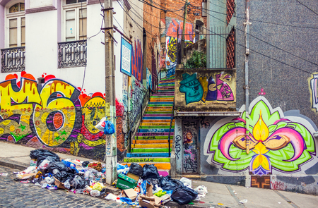 VALPARAISO, CHILE - OCTOBER 27, 2016: Colorful staircase and graffiti with a lot of litter. Valparaiso famous as a UNESCO World Heritage Site and also as one of the poorest and dangerous city in Chile Редакционное