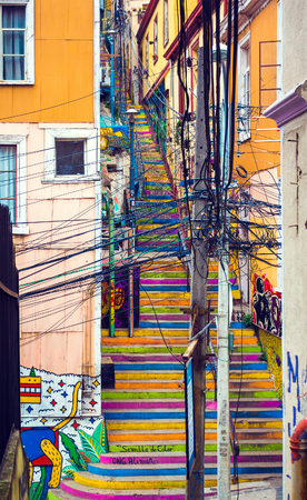 VALPARAISO, CHILE - OCTOBER 27, 2016: Colorful stairway with a lot of wires on the foreground. Valparaiso famous as a UNESCO World Heritage Site.