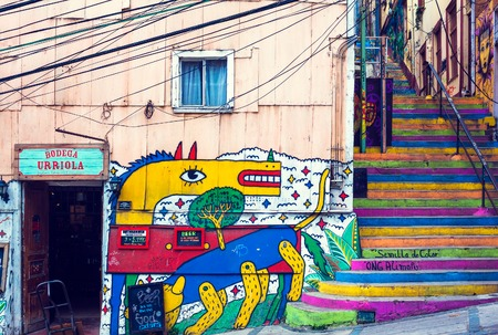 VALPARAISO, CHILE - OCTOBER 27, 2016: Colorful staircase and graffiti. Valparaiso famous as a UNESCO World Heritage Site. Редакционное