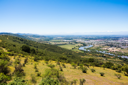 View of the mountains, river and city of Talca, Chile