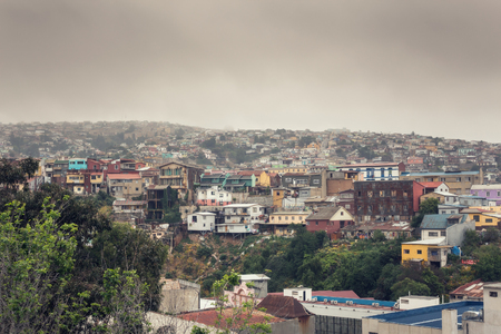 VALPARAISO, CHILE - OCTOBER 27, 2016: Central district of Valparaiso during gloomy weather. Valparaiso is most poorest and dangerous city in Chile. Фото со стока