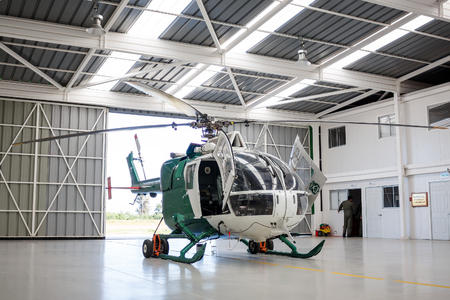 TALCA, CHILE - NOVEMBER 4, 2016: New police helicopter in the hangar. Carabiniers of Chile are the Chilean national police force, who have jurisdiction over the territory of Chile.