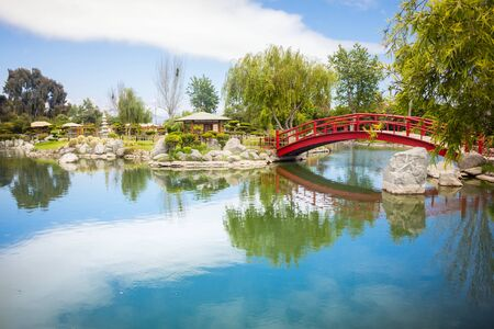 Beautiful japanese garden with red arc bridge and reflections in La Serena, Chile
