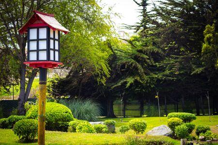 Closeup wtih decorative wooden lantern in japanese garden in La Serena, Chile