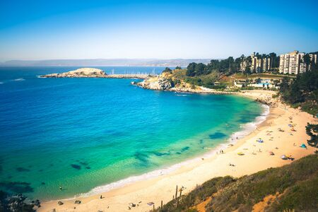 Aerial view of beach in Algarrobo with resting people, Chile