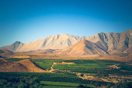 Chilean landscape with mountains and fields near Vicu?a