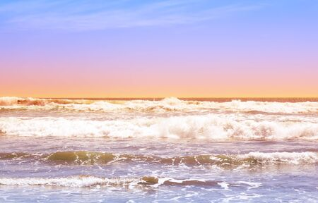 Beautiful waves of the pacific ocean at sunset in La Serena, Chile Фото со стока