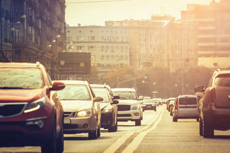 Cars standing in a line during traffic jam at sunset Stock Photo
