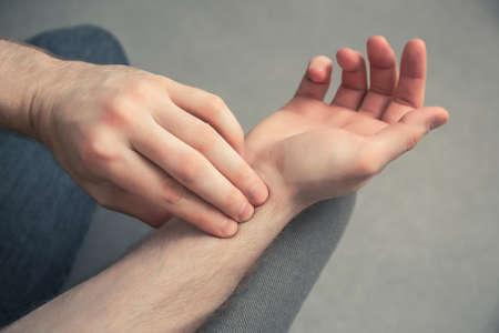 Closeup of man checking his pulse