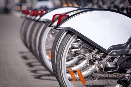 Wheels of bicycles at rental station Фото со стока