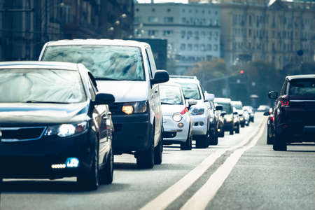 Cars standing in a line during traffic jam Фото со стока