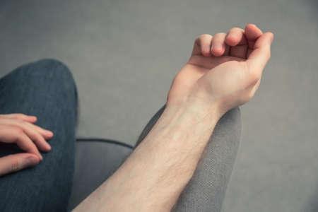 Man's arm on the armchair