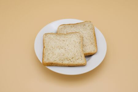 Whole Wheat Bread on a Dish Stock fotó