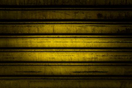 Yellow steel  shutterdoor background closeup texture photo