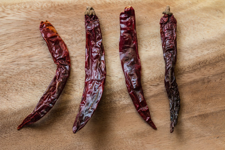 flavorings: Closeup of the dried chilli on the wood