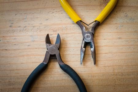 wirecutters: Old pliers and wirecutters on the wood background