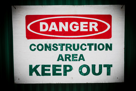 constraction: Closeup of the caution sign at the construction area Stock Photo