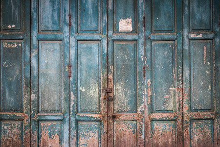 old doors: Closeup of the weathered old blue wood door background Stock Photo
