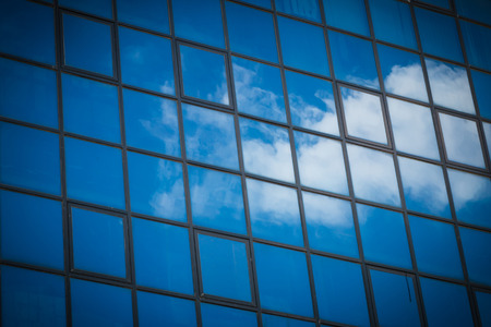 reflect: Closeup of the reflect of the cloud on the tower glass window background
