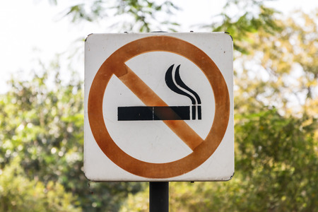 no smoking sign: Closeup of the no smoking sign in the garden background
