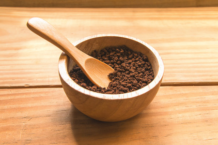 instant coffee: Instant coffee in wood bowl with wood spoon focus at instant coffee Stock Photo