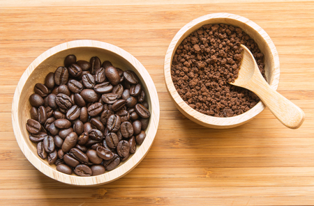 instant coffee: Coffee beans and instant coffee in the wood bowl Stock Photo