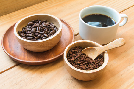 instant coffee: Instant coffee and coffee beans with white cup of coffee focus at instant coffee