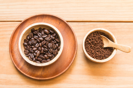brink: Coffee beans and instant coffee in the wood bowl Stock Photo