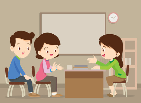 Parent meeting with teacher in classroom.