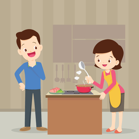 Man and woman in the kitchen.Husband look at wife cooking in the kitchen.